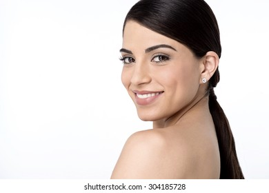 Bare shoulder woman posing to camera over white