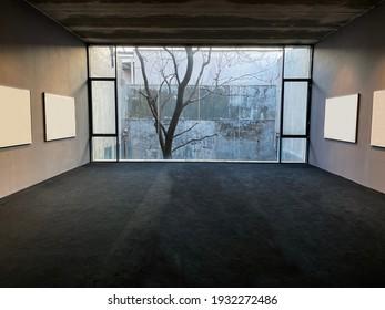 Bare tree seen trough open window at winter