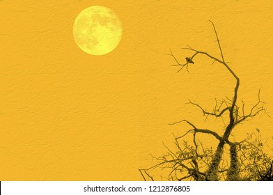 Bare tree with small bird and full moon on yellow background. Copy space for text or image. Elements of this image courtesy NASA.