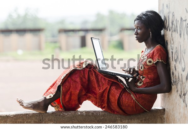 Barefoot African Model Working On Her Laptop Computer Business Symbol