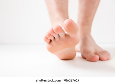 Barefoot. Cares about a man's clean and soft foot skin. Body care concept.