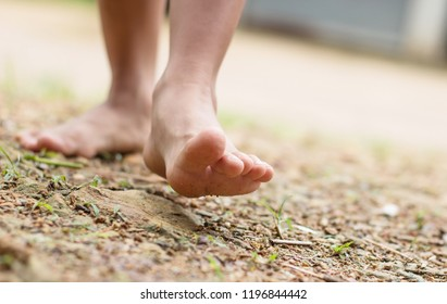 Barefoot child walk alone in nature, explore the forest,outdoor hiking activities.