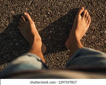 Barefoot feeling the hot road