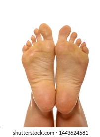Barefoot female feet seeing from sole, isolated on white backfround.