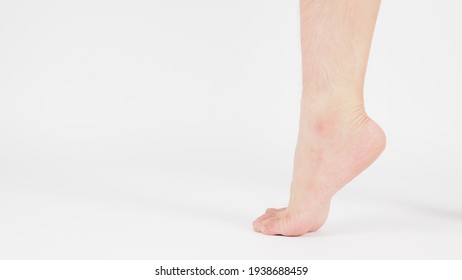 barefoot and legs of Asian Male is isolated on white background.