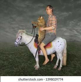 The barefoot man with his cat  is riding together on the white pony on the field.