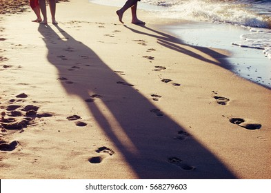 barefoot people on a beach