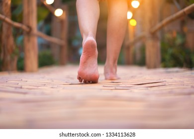 barefoot walking on the bamboo bridge with outdoor nature