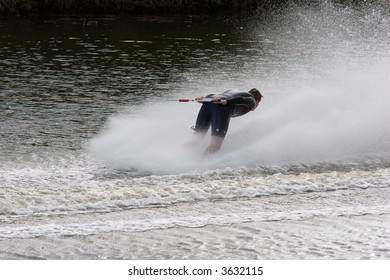 A barefoot waterskier going backwards