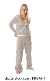 Barefooted blonde girl in sportswear isolated over white