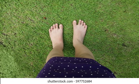 Barefooted child standing on green grass. Outdoors is the best place for children to practice emerging physical skills. They can freely experience motor skills like running, leaping, & jumping