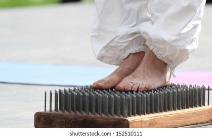 Barefooted foot of the girl on edges of nails