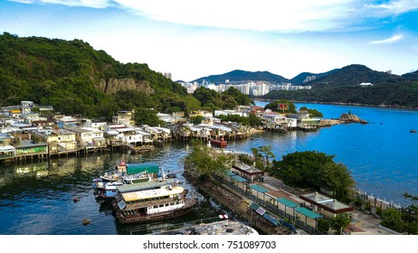The barely survived beautiful fishing village in Hong Kong at Lei Yue Mun, with fishing vessels and boats parked within the typhoon shelter