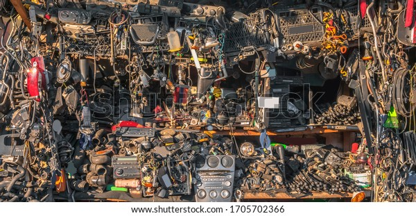 Bargain fair, trade of old and used parts of destroyed and demolished car. Multiple small parts for cars. Messy background of thousands of small and rusty parts of crushed and broken cars.