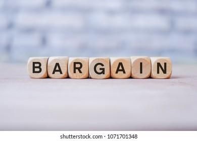 BARGAIN word written on wood block