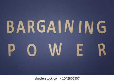 Bargaining Power written with wooden letters on a blue background to mean a business concept