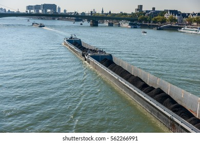 Barge with cargo on river. Elbe, Cologne