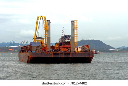 Barge with dredging equipment awaiting assignment