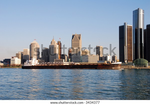 Barge in front of Detroit skyline