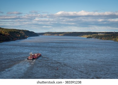 A barge makes it's way up the Hudson River.