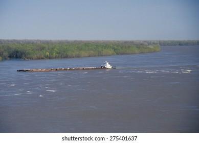 A barge in the Mississippi River in Vicksburg, Mississippi
