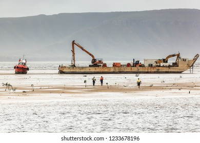 Barge on workboat salvage operation at Cooktown, North Queensland, Australia