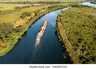 barge tug transporting commodity along the  river - Tiete-Parana Waterway
