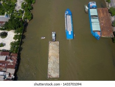 Barges carrying building materials along the busy canal separating districts 4 and 7 joining the Saigon River and Port area of Ho Chi Minh City (Saigon) Vietnam.