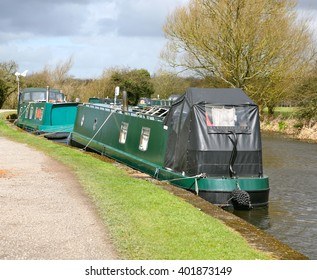Barges moored alongside the Red Rock Bridge at Haigh, Wigan, Lancashire, United Kingdom
