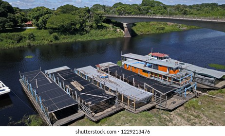 Barges on amazonian river in Pantanal at dry season, freight ship waiting to be loasded.