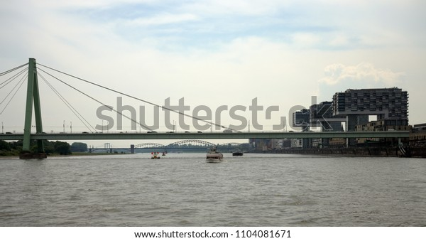 Barges on the Rhine in front of the crane houses