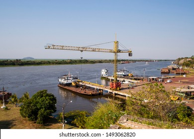 barges on the river to take grain harvest along the Paraguay River, Corumba, Mato Grosso do Sul, Brazil
