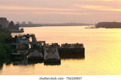Barges on a sunset in a harbor