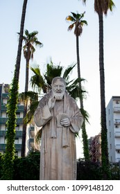 Bari, Italy - 04 22 2018: Statue of Padre Pio in the city of Bari, Italy, built in front of the hospital. A symbol of faith to protect the sick.