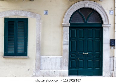 Bari, Italy - 04 22 2018: The exterior of a house characterized by a door and a window.