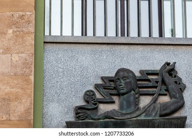 Bari, Italy - 04 25 2018: Iron bas-relief on the wall of the University of Bari, in southern Italy.