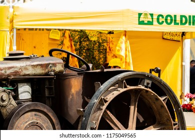 Bari, Italy - 04 29 2018: An old tractor exposed during a fair in town on agriculture and typical Italian products.