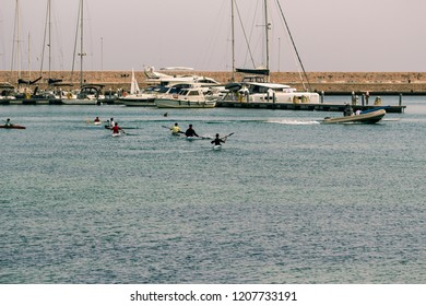 Bari, Italy - 04 29 2018: Canoe training on the sea, in the background of the coast of the city of Bari, in Italy