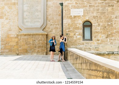 Bari, Italy - 04 29 2018: Turists on holiday in Bari, in southern Italy, take photos for the city.