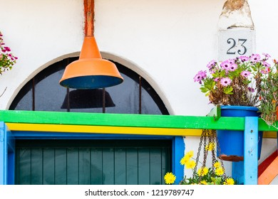 Bari, Italy - 04 29 2018: A shop of flowers and very colorful wooden exteriors.