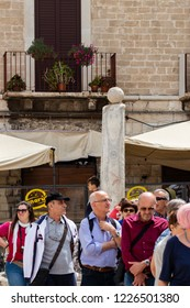 Bari, Italy - 04 29 2018: Morning in the historic center of the city of Bari, in Italy. Tourists around the streets.