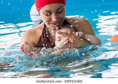 Bari, Italy - 05 13 2018: A thirty minute lesson in the pool to educate and strengthen the relationship between mother and child in the water.