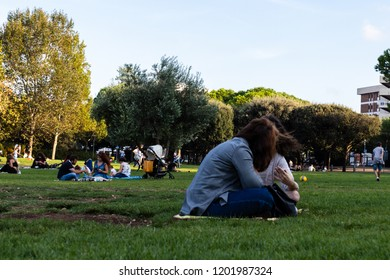 Bari, Italy - 09 09 2018: Families and friends during an afternoon at the park
