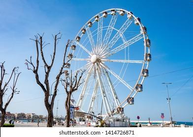 Bari, Italy, 23.4.2019: Giant panorama wheel in Bari. Famous wheel in center of town.