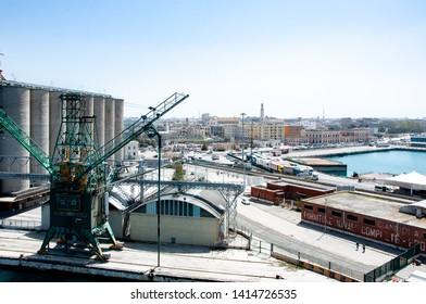 Bari, Italy, 23.4.2019: Indrustrial port. Ships, trucks, cranes in Port Bari. Cargo