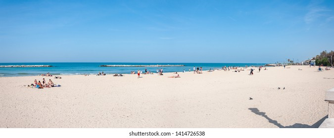Bari, Italy, 23.4.2019: Sand beach with a lot of people in Bari, Italy. Summer vacation of many people in Italy.