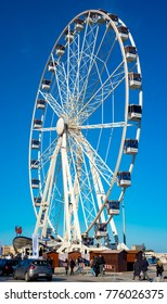 Bari, Italy - December 8, 2017: Big Ferris wheel installed on the waterfront of Bari to cheer Christmas 2017