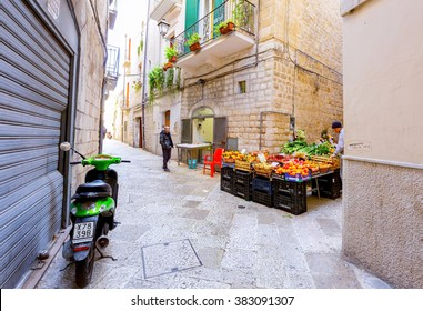 BARI, ITALY- FEBRUARY 27, 2016; Local grocery and vegetable market on street in old town Bari, Italy. Bari is a port city and the capital of southern Italy's Puglia region.