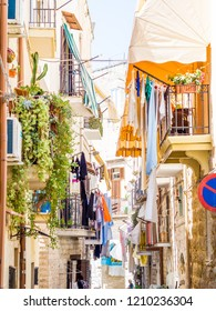 Bari, Italy - Jul 8, 2018: View of a narrow street in the Italian city Bari. Bari is the capital city of the Metropolitan City of Bari and of the Apulia region, on the Adriatic Sea, in southern Italy