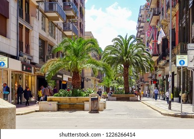 "Bari, Italy - July, 2014: Alley of palms on the street ""Corso Vittorio Emanuele"" at Bari city. Bari is capital city of Metropolitan City of Bari and of Apulia region, on the Adriatic Sea"